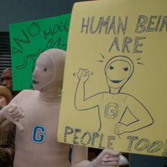 <center><b>Protester Human Being</b></center><center><b>Appearance</b>: