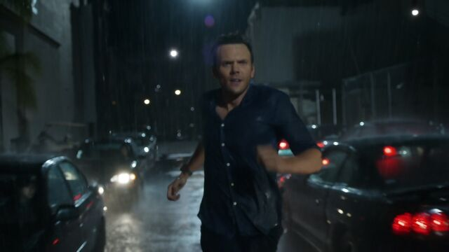Jeff running in the rain
