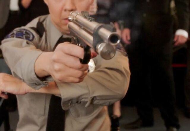 File:Chang's tranquilizer gun.jpg