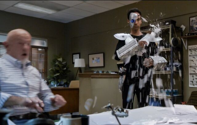 File:5X7 Abed sprays Hickey's desk.jpg