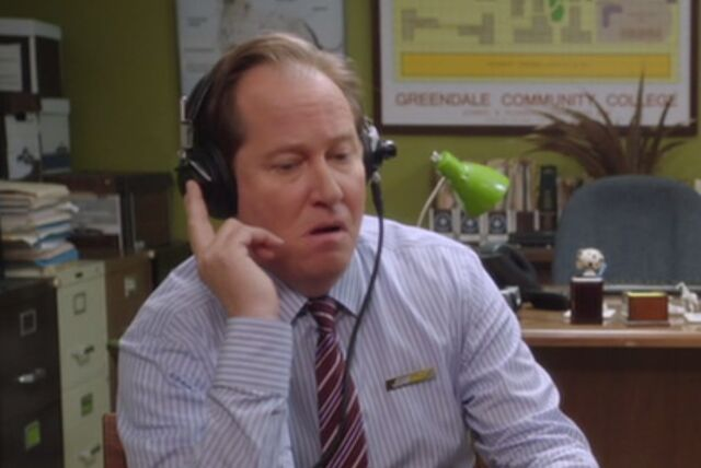 File:S03E13-Subway Rep listens to tape.jpg