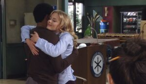 S03E08-Britta and Troy hug and foosball table