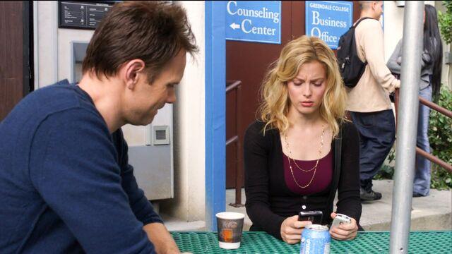File:1x11 Britta looks at Jeff's contact list.jpg