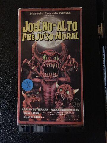 File:Joelho-Alto Prejuizo Moral VHS cover front.jpg