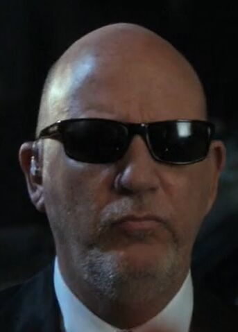 File:S02E06-Man in suit.jpg