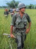 553909us-army-captain-robert-bacon-leading-a-patrol-during-the-early-years-of-the-vietnam-war-posters