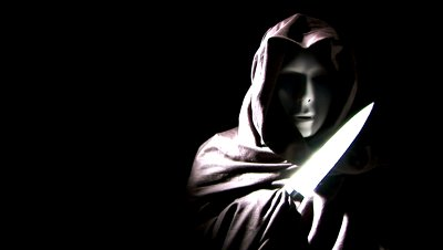 File:Stock-footage-a-person-masked-and-cloaked-in-black-flashing-a-knife.jpg