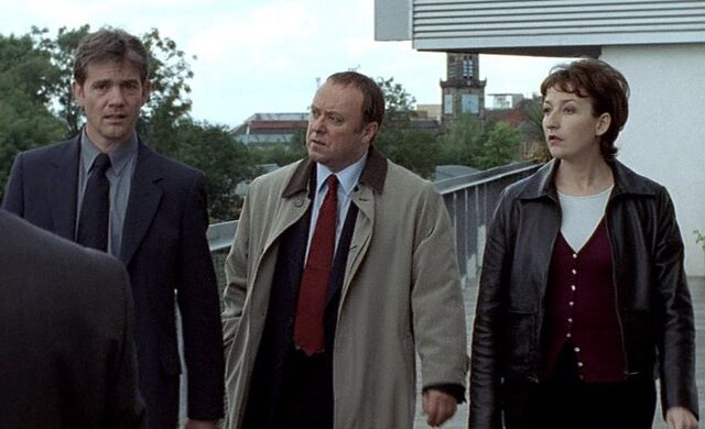 File:The team when Stuart gets the call from Langbank in Death Trap.jpg