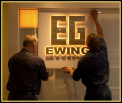 Ewing Global sign