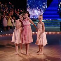Brynn Rumfallo snuggle-hugging Maddie Ziegler who reaches for Jaycee Wilkins - Dancing with the Stars