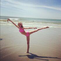 Paige arabesque on the beach