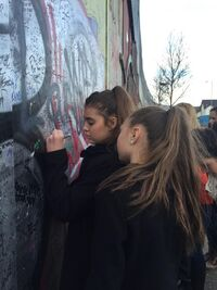 Kalani writing left handed on wall in Belfast - 3March2015