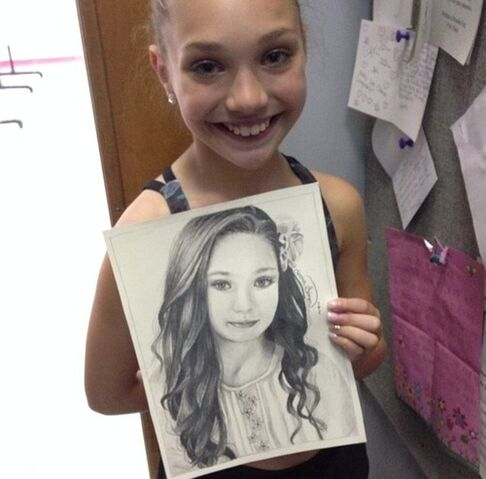 File:Maddie with picture.jpg