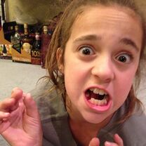Kaycee pulling out her own loose tooth 2013-03-08