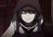 Komaru hiding under her parachute