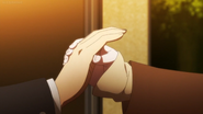 Chiaki grabs Hajime's hand