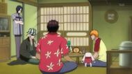 Urahara discusses the rebellion with Ichigo, Chad, and Uryu