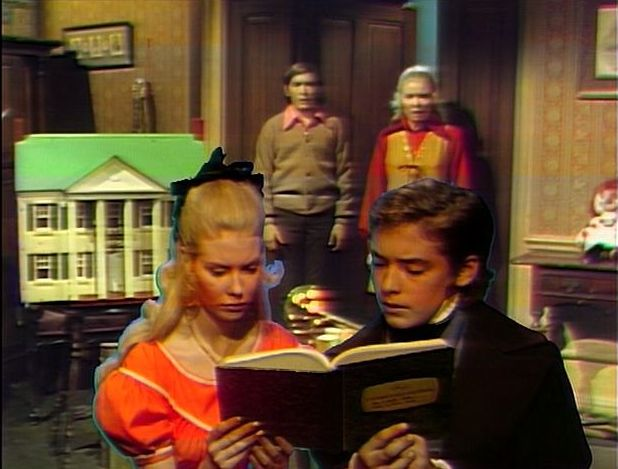 File:Tad and Carrie reading notebook while David and Hallie enter playroom.jpg