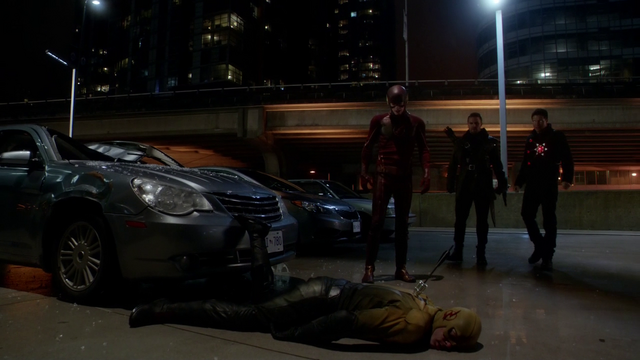 File:The Flash, Firestorm, and The Arrow stand over a defeated Reverse-Flash.png