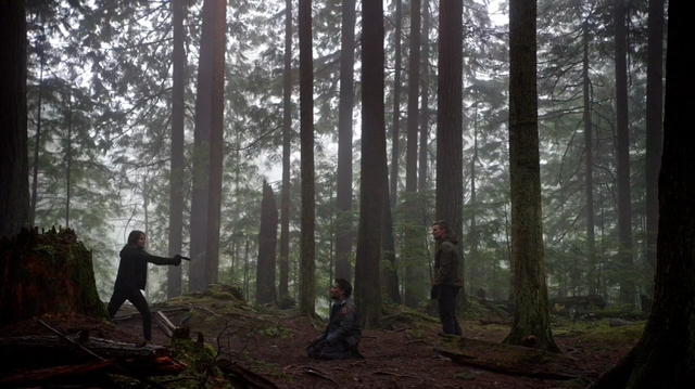 File:Thea aims a gun at Slade Wilson.png