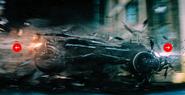 Batmobile crashing through rubble