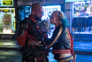 Harley Quinn approaches Deadshot