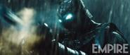 Batman wielding a weapon