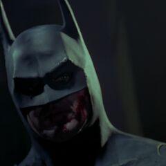 Batman arrives to save Vicki.