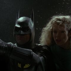Batman about to get Vicki to safety.