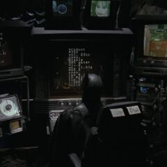 Batman sitting at the Batcomputer.