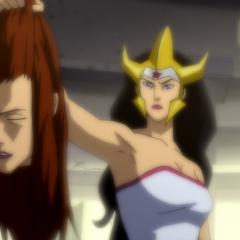 Wonder Woman holding Mera's decapitated head.
