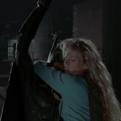 Batman lifts Vicki to safety.