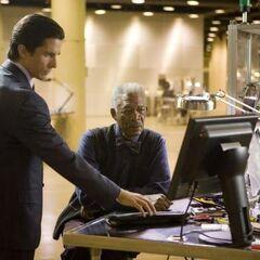 Bruce Wayne with Lucius Fox in <i>The Dark Knight</i>.