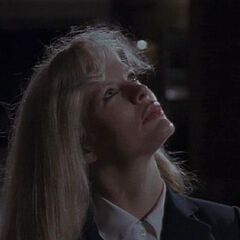 Vicki looks up at the Batsignal.