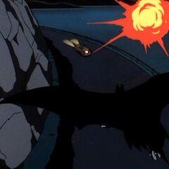 Batman pursues a robotic thief.