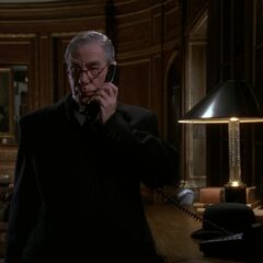 Alfred on the phone after witnessing the Joker's TV debut.