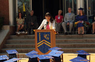 Ms. Oh speaking at graduation