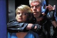DHS- Erika Eleniak and Ron Perlman in Shakedown (2002)
