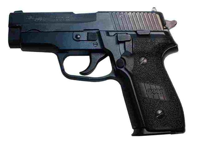 File:In-the-Line-of-Fire-Frank-Horrigan-Clint-Eastwood-9MM-SIG-Sauer-P228-Screen-Used-Hero-Pistol-1.jpg