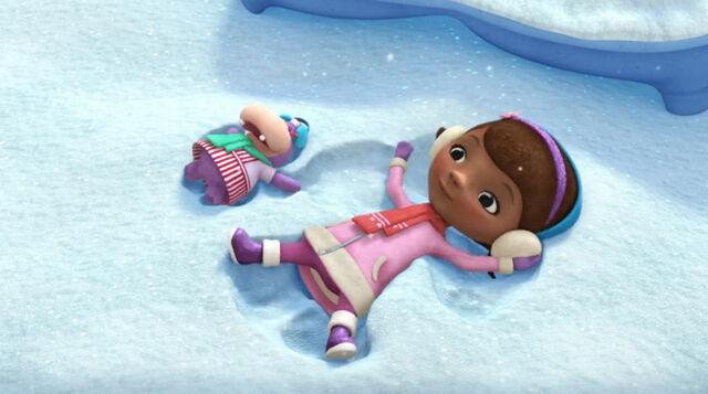 File:Doc and hallie making snow angels.jpg