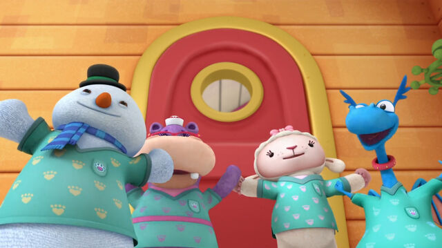 File:Four toy characters in their vet vests.jpg
