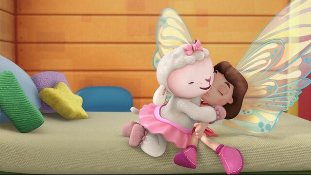 File:Lambie gives frida fairy a cuddle.jpg