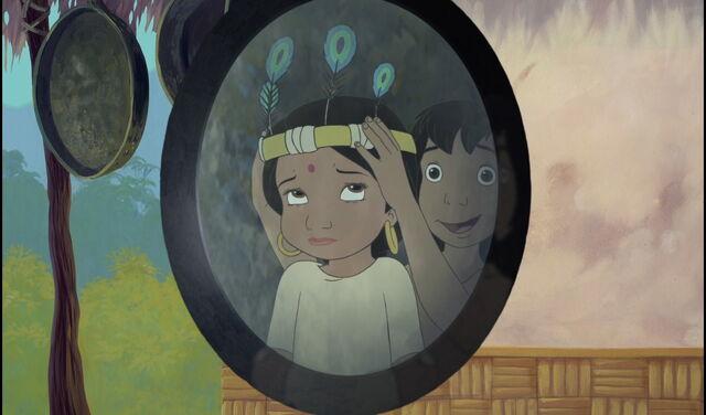 File:Mowgli gives Shanti a feather hat.jpg