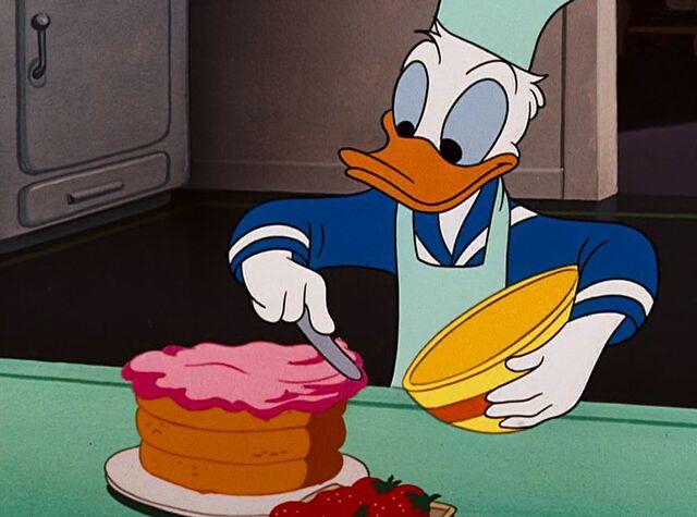 File:Donald putting icing on a cake.jpeg