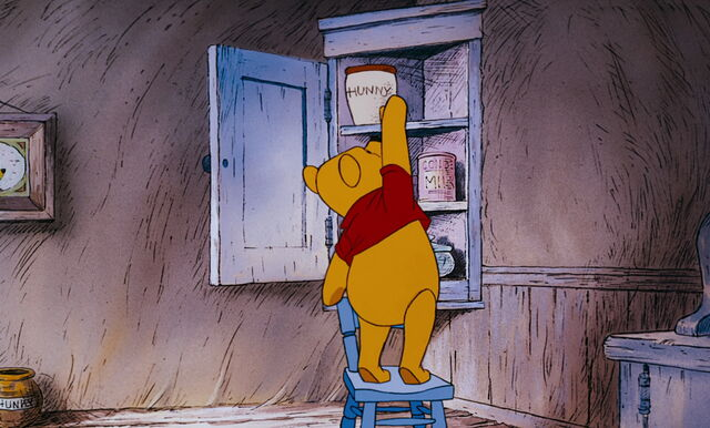 File:Winnie the Pooh is reaching the honey pot in the cupord.jpg