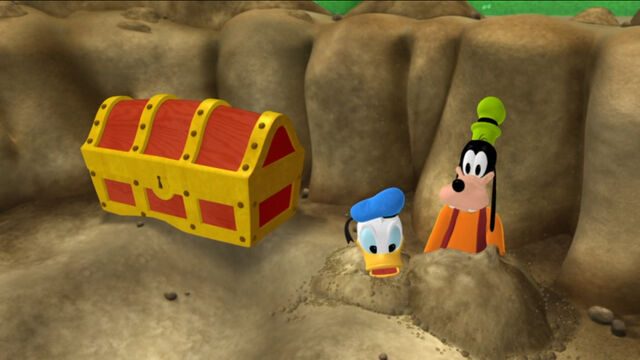 File:Donald and goofy pop out from the dirt.jpg