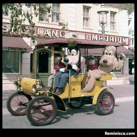 File:Goofy and pluto in main street car.jpg