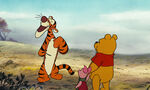 Tigger is off to find Rabbit