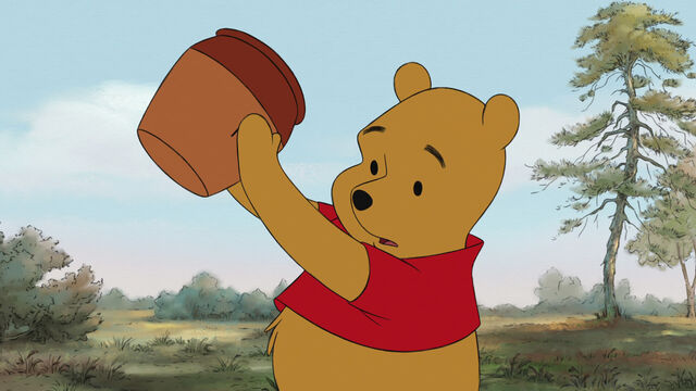 File:Winnie the Pooh is holding an empty honey pot.jpg