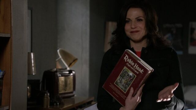 File:Once Upon a Time - 5x22 - Only You - Regina with Robin Hood book.jpg